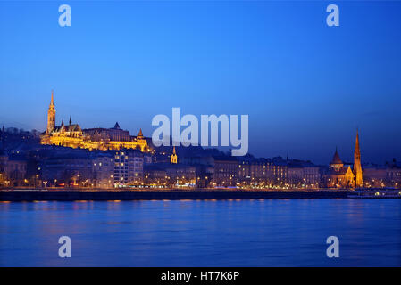 The 'Fisherman's bastion' and Matthias church on the side of Bude, as seen from the side of Pest, Budapest, Hungary. - Stock Photo