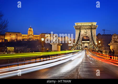 Széchenyi bridge (or 'Chain Bridge') over Danube river and the Royal Palace. Budapest, Hungary. - Stock Photo