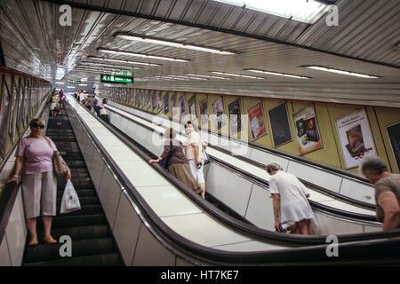people on escalators. budapest, hungary, may 21, 2009: people on escalators in metro station