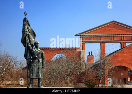 Statues of the Communist Era (examples of the 'socialist reallism') in the Memento Park, an open-air museum about - Stock Photo