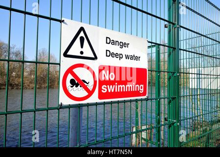 No Swimming sign on a fencing by river Thames west London UK - Stock Photo