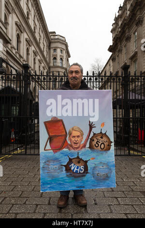 London, UK. 8th Mar, 2017. Satirical artist, Kaya Mar outside Downing Street with his new Budget Day painting of - Stock Photo