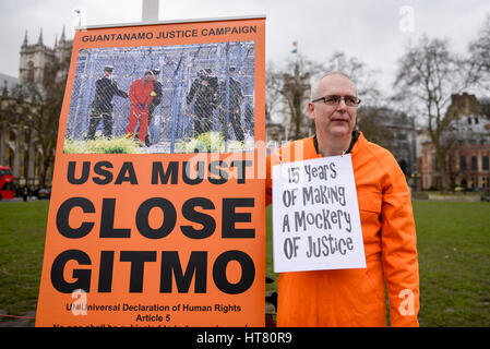 London, UK.  8 March 2017.  Members of Guantanamo Justice Campaign stage a protest in Parliament Square opposite - Stock Photo