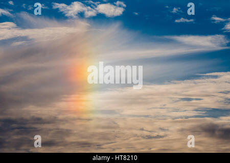 Aberystwyth Wales UK,  08 March 2017 UK weather; A 'sun dog' rainbow appears in the sky at dusk in Aberystwyth on - Stock Photo