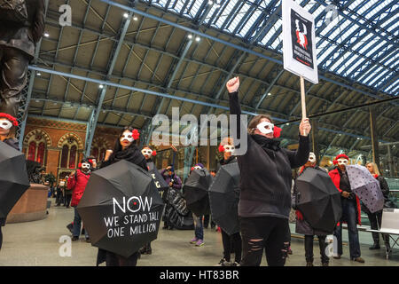 London, UK. 8th Mar, 2017. Women from protest group Women's Strike UK and Polish feminists protest at St Pancras - Stock Photo