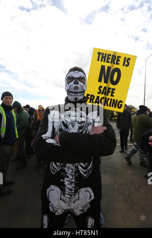 Fylde, Lancashire, UK. 8th Mar, 2017. A man wearing a skeleton outfit stood in front of a sign which reads 'There - Stock Photo