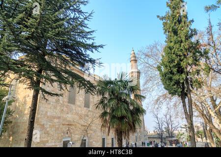 Ulucami mosque with trees in Bursa, Turkey - Stock Photo