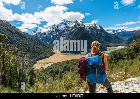 Hiker overlooks the Routeburn Flats, Routeburn Track, behind Humboldt Mountains, Westland District, West Coast, - Stock Photo