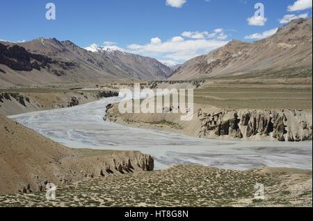 Tsarap River melt-water and its mountain source in Kashmir, between Sarchu and Pang. - Stock Photo