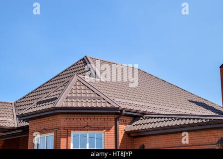 Detached House With A Roof Made Of Steel Sheets. Roof Metal Sheets. Modern  Types
