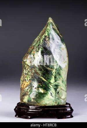 19th Century Chinese mythological mountain shape jade scholars rock. - Stock Photo