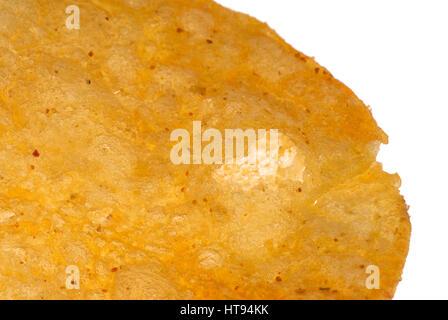 macro shot of a single potato chip - Stock Photo