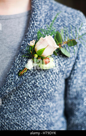 Gentle groom boutonniere with roses and beads. Close up - Stock Photo