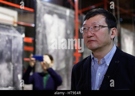 Curator of the exhibition 'Leaving the peony arbour' from China Gu Janzen in the Marble hall of the Russian ethnographic - Stock Photo