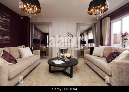 Home interior, lounge, living room, purple decor, purple feature wall, beige furniture, cream, carpet, fireplace, - Stock Photo