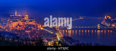 Night falling in Budapest, Hungary. View from Gellert Hill and Citadella castle, on the side of Buda. - Stock Photo