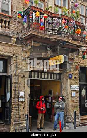 The entrance of 'Szimpla Kert' one of the oldest and most famous 'Ruin-pubs' in Budapest, Hungary - Stock Photo