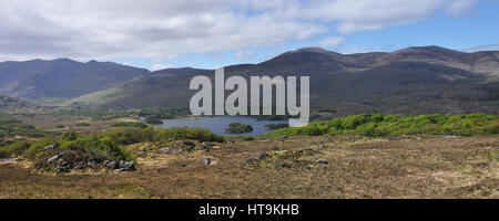 Mountains Lake and Green Bushes in the Irish Countryside - Stock Photo