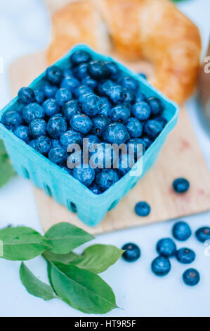 Fresh berries and croissant for brunch with white background - Stock Photo