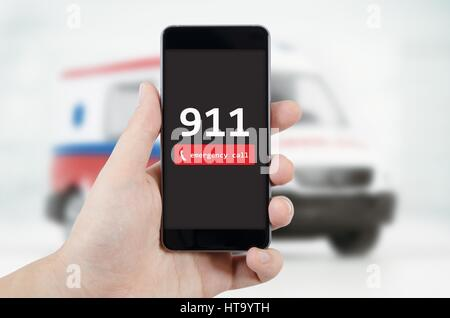 Man calling emergency. Ambulance in background. emergency call 911 aid man concept - Stock Photo
