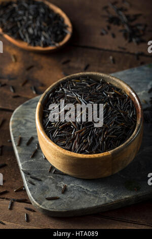 Organic Dry Black Wild Rice in a Bowl - Stock Photo