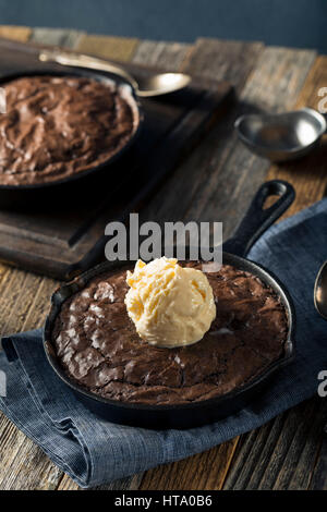 Homemade Sweet Dark Chocolate Brownie in a Skillet Ready to Eat - Stock Photo