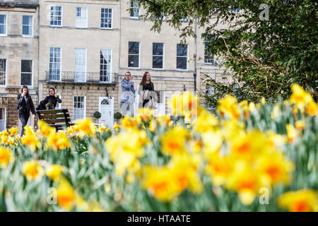 Bath, UK, 9th March, 2017. Women enjoying the warm UK weather and the warm spring sunshine are pictured walking - Stock Photo