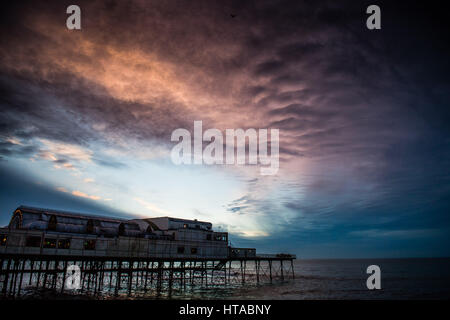 Aberystwyth, Wales, UK. 9th March, 2017. UK Weather: Dramatic underlit clouds form at sunset over the pier in Aberystwyth, - Stock Photo
