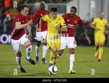 Rostov On Don, Russia. 9th Mar, 2017. FC Manchester United's Phil Jones (L), Ashley Young (R) and FC Rostov's Dmitry - Stock Photo