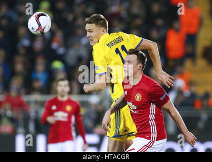 Rostov On Don, Russia. 9th Mar, 2017. FC Manchester United's Phil Jones (front) and FC Rostov's Alexander Bukharov - Stock Photo