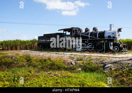 Trinidad, Cuba - December 20, 2016:  Old rusted steam engine of an old-fashioned locomotive train in front of a - Stock Photo