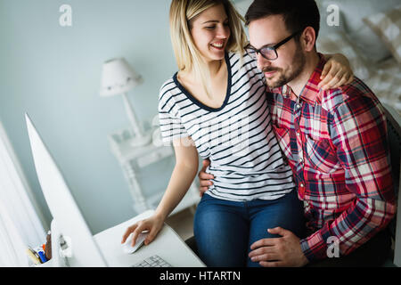 Couple in love shopping and buying goods from internet - Stock Photo