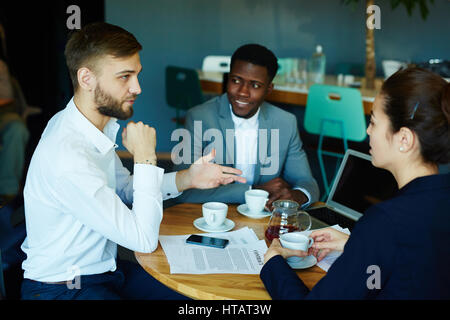 Businessman talking to one of candidates for new vacancy - Stock Photo