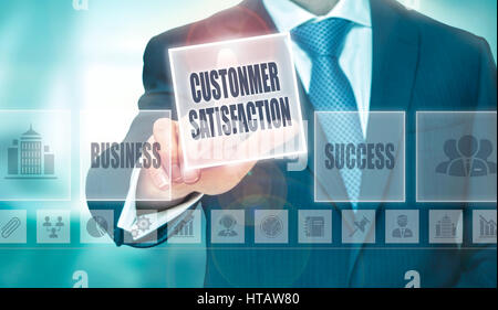 A businessman pressing a Customer Satisfaction button on a transparent screen. - Stock Photo