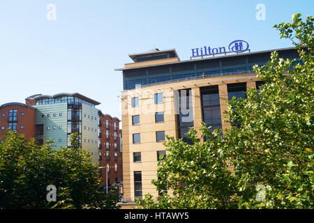 NEWCASTLE UPON TYNE, ENGLAND, UK - AUGUST 13, 2015: The Hilton Hotel beside Newcastle's Tyne Bridge. - Stock Photo