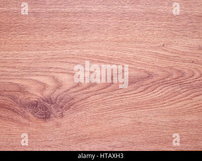 Vertical, top down aerial view of a wood laminate wood plank, textured grain background. - Stock Photo