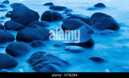 Stones in the water at the blue hour in Lohme on R?gen, Steine im Wasser in der blauen Stunde in Lohme auf Ruegen - Stock Photo