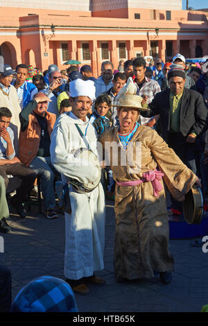 Entertainers in the Jemaa el-Fnaa square in  Marrakech, Morocco - Stock Photo