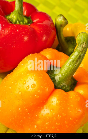 red and yellow sweet peppers - Stock Photo