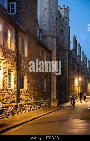 Students on Trinity Lane, outside Trinity College, at dusk, Cambridge, England, UK - Stock Photo