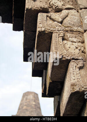 A detail of a carved relief at Borobudur Temple in Indonesia. - Stock Photo