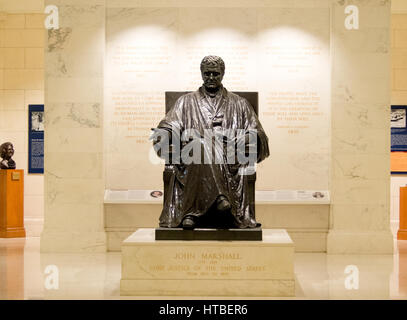 A statue of Cheif Justice John Marshall inside the United States Supreme Court building in Washington DC. - Stock Photo