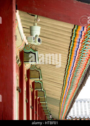 Detail of colorful painted eaves at a palace in Seoul, South Korea. - Stock Photo