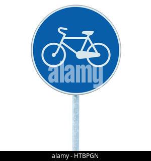 Bicycle lane road sign indicating bike route, large blue round isolated roadside traffic signage closeup, pole post - Stock Photo