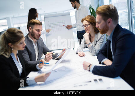 Colleagues attending seminars and business meetings in company office - Stock Photo