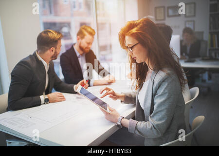 Happy business colleagues working in company office - Stock Photo