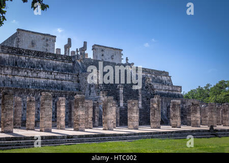 Carved columns at Mayan ruins of Temple of the Warriors in Chichen Itza - Yucatan, Mexico - Stock Photo