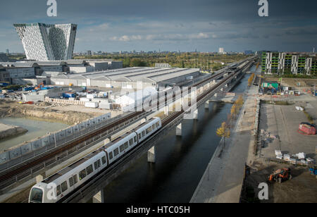 New Ørestad developments, the Leaning Towers of the Bella Sky Hotel by Copenhagen metro train - Stock Photo