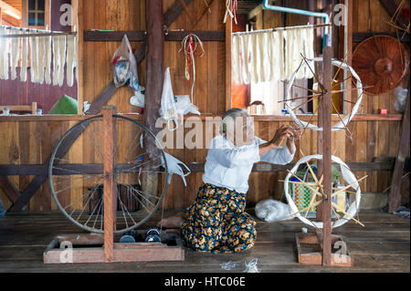Myanmar (ex Birmanie). Inle lake. Shan state. The weaving of lotus Silk fabric from the stalks of the lotus plant - Stock Photo