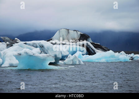 Iceland's Jokulsarlon - glacial lake with blue drifling icebergs on the edge of Vatnajökull National Park, situated - Stock Photo